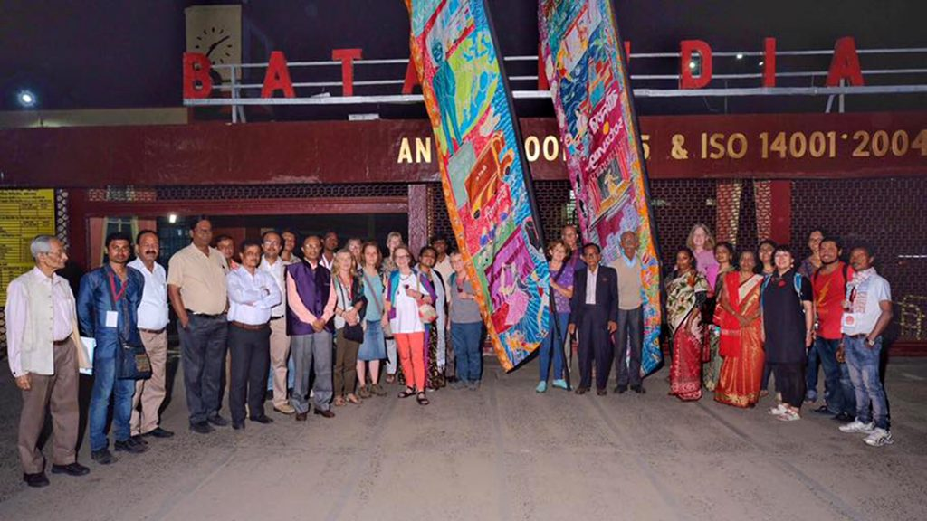 East Tilbury and Batanagar flags, with Silk River delegation, outside Bata India factory